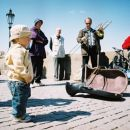 A child listening to the Bridge band.