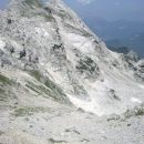 Razgled na vrh Cmira in našo nadaljno pot spusta v smeri Za Cmirom