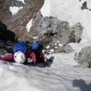 Spust na sedelce med vzhodnim predvrhom in vrhom Kamnitega lovca
