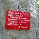 Opozorilna tabla pred vstopom v plezalni del