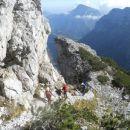 Kopinškova pot na Ojstrico (zadaj levo razgled na Raduho, desno Križevnik)