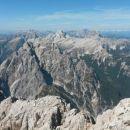 Razgled iz vrha na Bavški Grintavec, Prisojnik, Jalovec, Mojstrovke, Mangart in Ponce