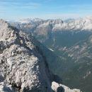 Razgled z vrha na Kanin, Jalovec in Mangart (od leve proti desni)
