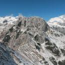 Razgled iz vrha na Triglav, Mali Draški vrh in Rjavino (od leve proti desni)