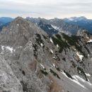 Razgled iz vrha na Obir, Peco, Palec, Košutico, Košuto, Grintovec, Kočno in Storžič