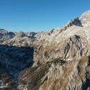Razgled iz vrha na Mišelj Konec, Mišelj vrh, Kanjavec, Šmarjetno glavo in Triglav