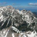 Razgled z vrha Begunjščice na Vrtačo, Zelenjak in Palec (od leve proti desni)