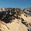 Razgled z Viševnika na Triglav, Mali Draški vrh in Rjavino (od leve proti desni)