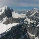 Razgled z vrha Male Mojstrovke na Veliko Mojstrovko (levo) in Mangart (desno)