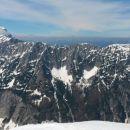 Razgled z vrha Male Mojstrovke na Mangart, Vevnico, Strug in celoten greben Ponc
